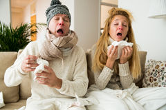 Sick couple catch cold. stock images