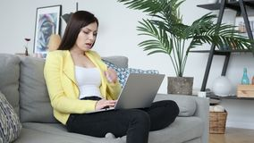 Sick Creative Woman Coughing while Sittting on Sofa and Typing on Laptop. 4k , high quality stock footage