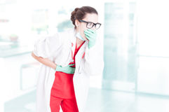 Sick doctor having indigestion. Or belly pain and vomiting as gastrointestinal infection concept Royalty Free Stock Photo
