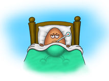 Sick egg lies in bed with thermometer in mouth Royalty Free Stock Photo