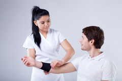 Sick elbow rehabilitation Stock Images