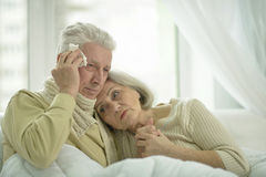Sick  elderly couple in bed. Portrait of sick  elderly couple in bed Royalty Free Stock Photo