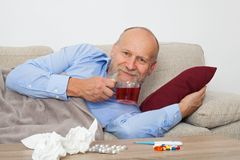 Sick elderly man stock image