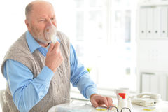 Sick elderly man makes inhalation Royalty Free Stock Photo