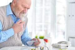 Sick elderly man makes inhalation Stock Photo