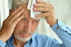 Sick elderly man. Portrait of a sick elderly man closeup Stock Photography