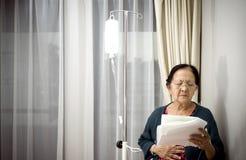 Sick elderly patient in hospital ward stock photos