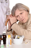 Sick elderly woman with a physician Stock Photography