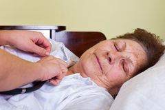 Sick elderly woman Stock Photo