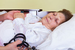 Sick elderly woman Stock Image
