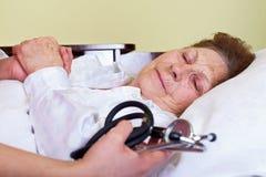 Sick elderly woman Stock Image