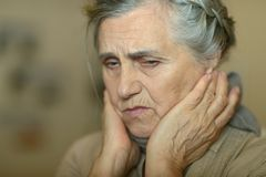 Sick elderly woman Royalty Free Stock Image