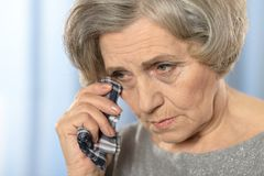 Sick elderly woman Stock Images