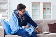 The sick employee staying at home suffering from flue. Sick employee staying at home suffering from flue Royalty Free Stock Photography