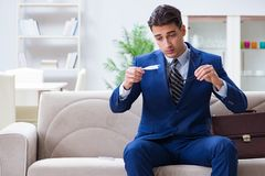 The sick employee staying at home suffering from flue. Sick employee staying at home suffering from flue Stock Photos