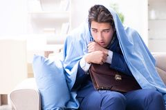 The sick employee staying at home suffering from flue. Sick employee staying at home suffering from flue Stock Photo