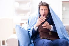 The sick employee staying at home suffering from flue. Sick employee staying at home suffering from flue Stock Images