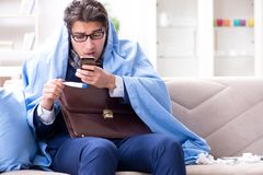 The sick employee staying at home suffering from flue. Sick employee staying at home suffering from flue Stock Photography