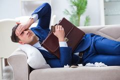 The sick employee staying at home suffering from flue. Sick employee staying at home suffering from flue Royalty Free Stock Images