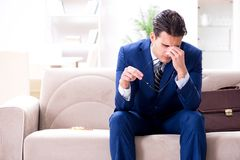 The sick employee staying at home suffering from flue. Sick employee staying at home suffering from flue Stock Image