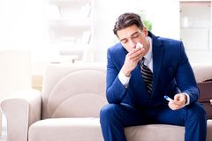 The sick employee staying at home suffering from flue. Sick employee staying at home suffering from flue Royalty Free Stock Photo
