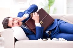 The sick employee staying at home suffering from flue. Sick employee staying at home suffering from flue Royalty Free Stock Photos