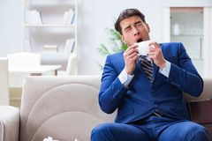 The sick employee staying at home suffering from flue. Sick employee staying at home suffering from flue Royalty Free Stock Image