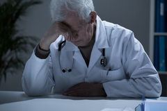 Sick exhausted doctor Royalty Free Stock Photos