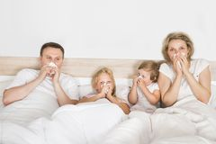 Sick family lying in bed. At Home royalty free stock image