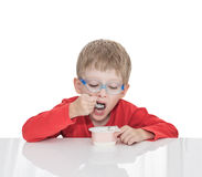The sick five-year-old boy sits at a white table with medicine healthcare mask for is protection again virus Stock Photos