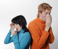 Sick flu man and woman, sneeze on each other Royalty Free Stock Photos