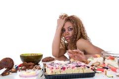 Sick girl. Pretty black girl having just been on a food binge royalty free stock photo