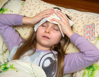 Sick girl. Lying in bed Royalty Free Stock Images