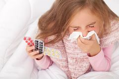 Sick Girl On Bed Sneezing In Handkerchief In Bedroom.  Royalty Free Stock Photos