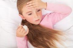 Sick Girl On Bed Sneezing In Handkerchief In Bedroom.  Royalty Free Stock Photography