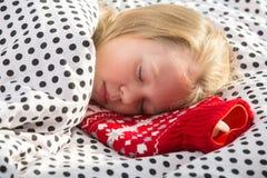 Sick girl in bed taking medicine Stock Image