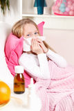 Sick girl blowing nose Stock Images