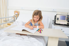 Sick girl coloring book in hospital Stock Photography