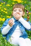 Sick girl coughing. Little sick girl coughing outdoors Royalty Free Stock Photography