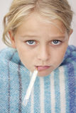 Sick girl with fever Royalty Free Stock Images