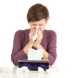 Sick girl with flu blowing her nose Stock Photo