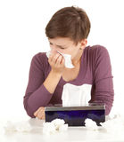 Sick girl with flu blowing her nose Royalty Free Stock Photos