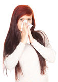 Sick girl with flu blowing her nose Royalty Free Stock Photography