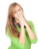 Sick girl with flu blowing her nose Royalty Free Stock Image