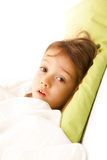 Sick girl in her bed. Sick little girl on bed with Royalty Free Stock Images
