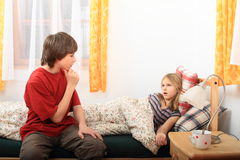 Sick girl with her brother Royalty Free Stock Image