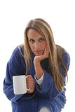 Sick girl in housecoat with a cup of tea Stock Photo