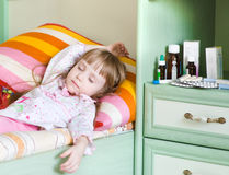 Sick girl lying on a bed Royalty Free Stock Photography