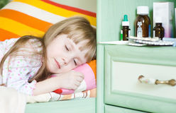 Sick girl lying on a bed Royalty Free Stock Photo