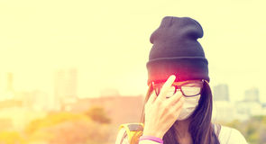 A Sick girl with mask protection having fever Royalty Free Stock Images